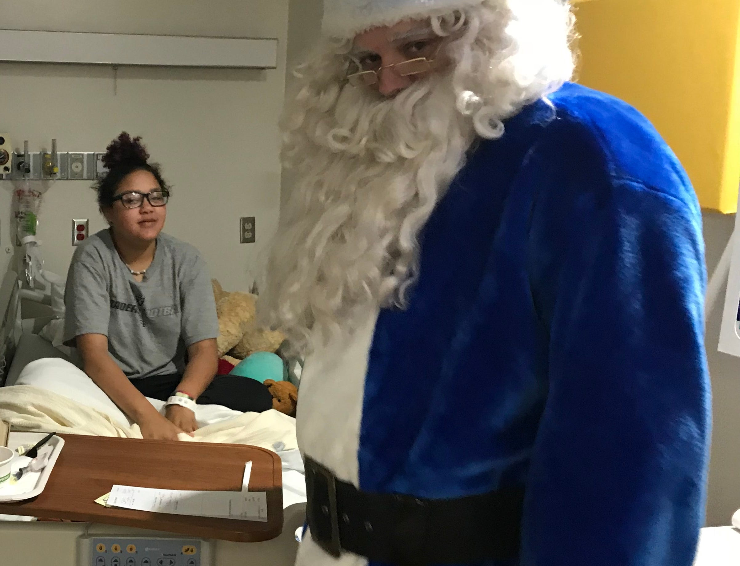 Among those Blue Santa visited during his rounds Friday was 15-year-old Isis Belbal-Andrews, a patient in the pediatrics ward at Mercy Medical Center in Redding.
