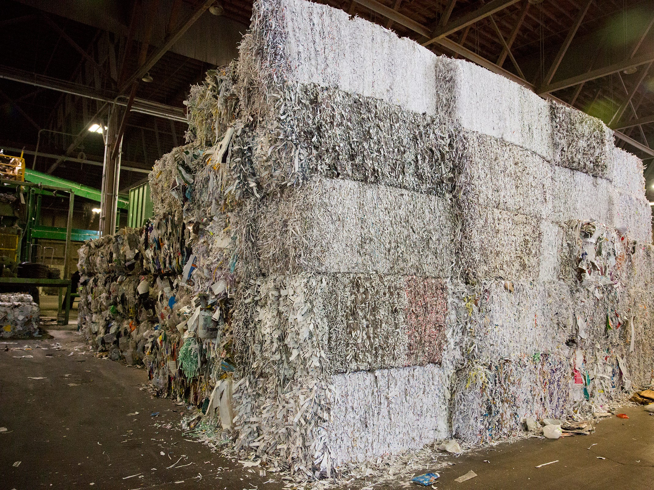 Blocks of paper are stacked at Garten Recycling in Salem on Thursday, Dec. 20, 2018. Paper recycling is not as common as it used to be.
