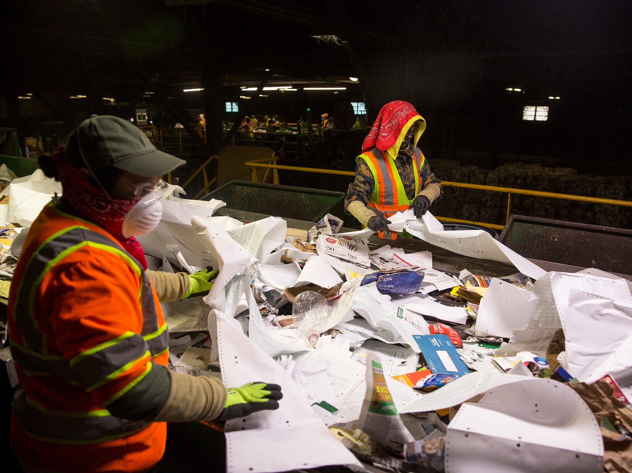 Garten Recycling Center employees separate recyclable and non-recyclable items at Salem on Thursday, Dec. 20, 2018.