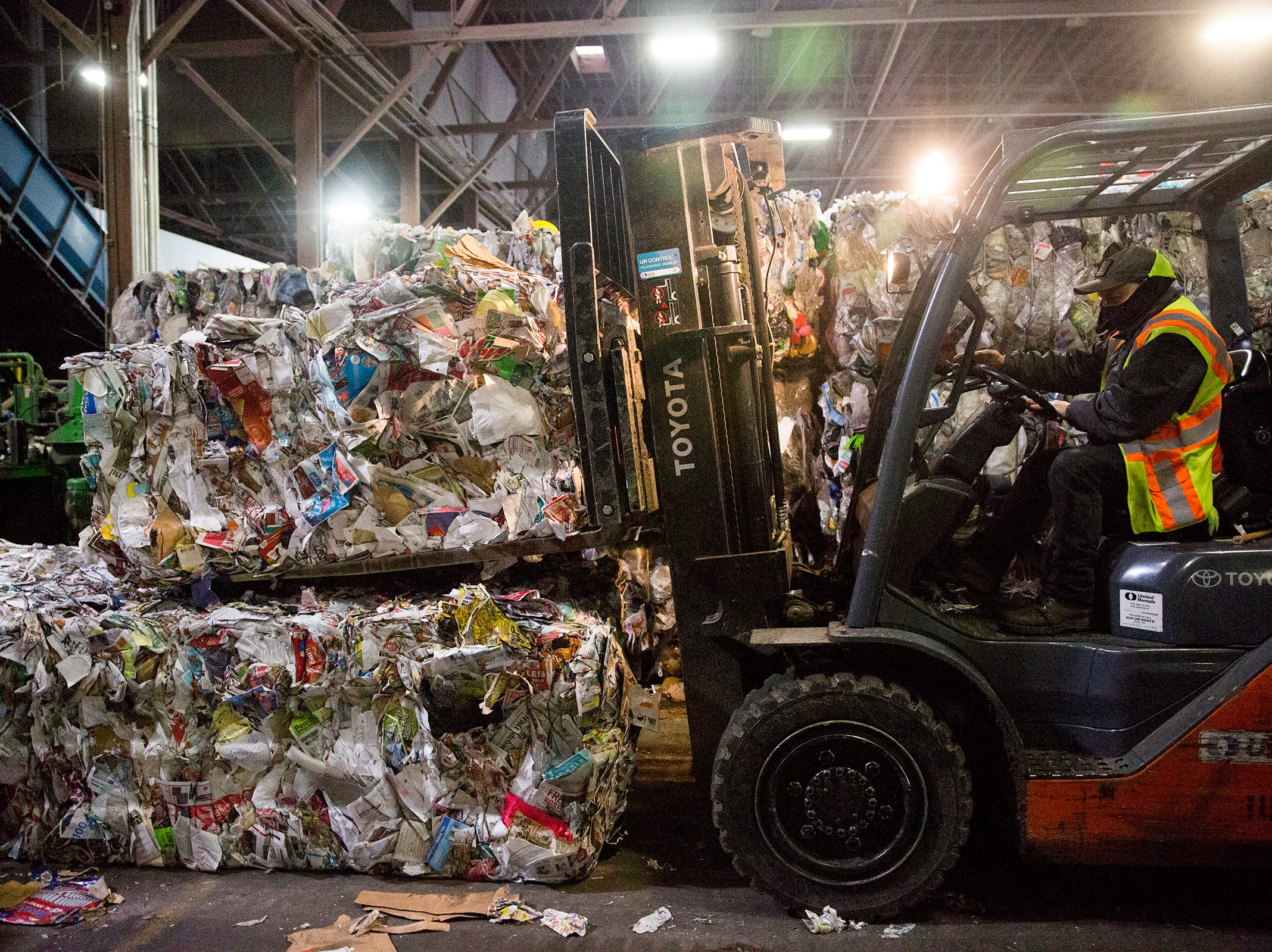 A Garten Recycling employee uses a forklift to stack blocks of paper in Salem on Thursday, Dec. 20, 2018.