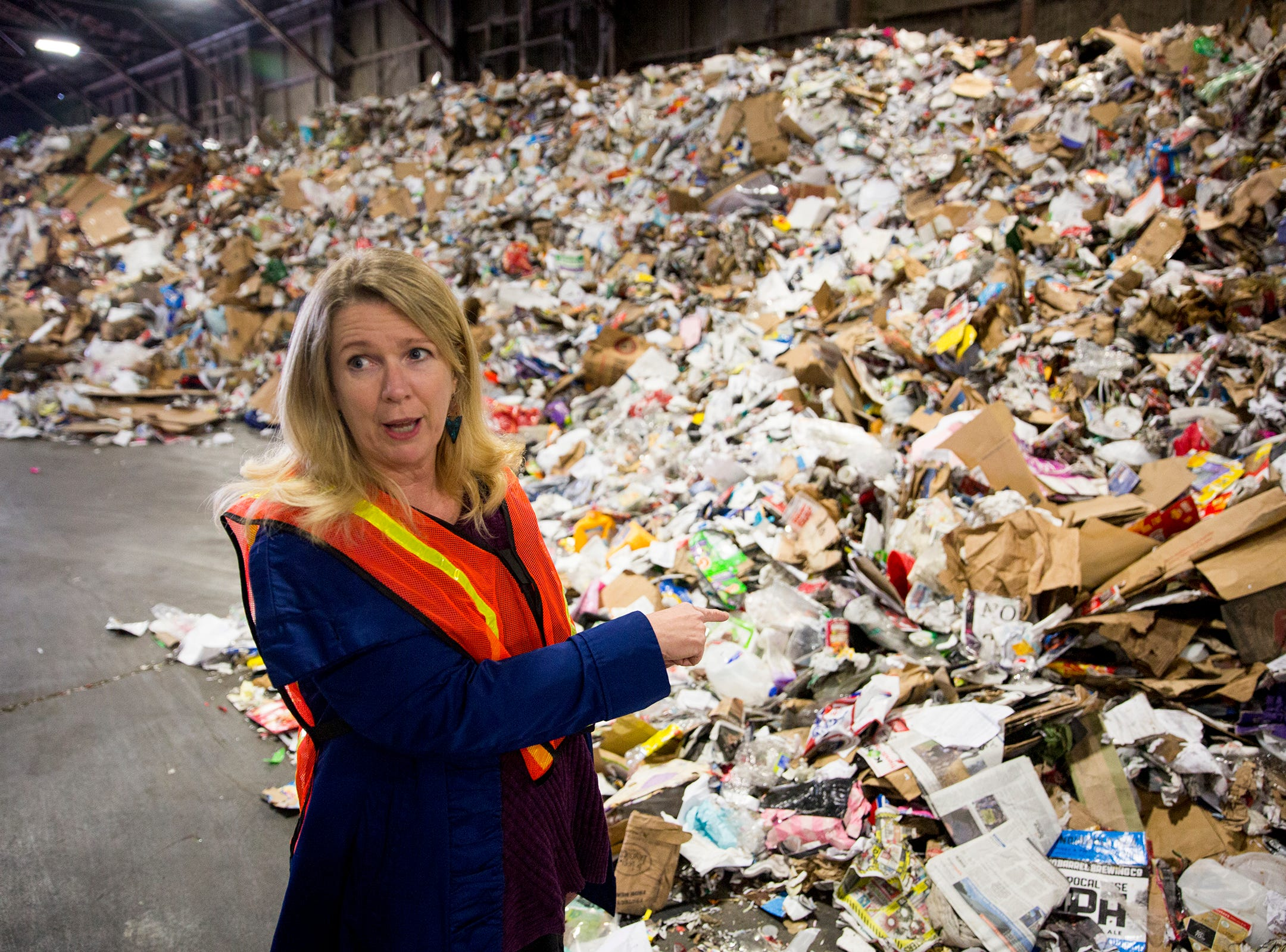 Resource Development Manager Gaelen McAllister points to the build up of items that cannot be recycled at Garten Recycling in Salem on Thursday, Dec. 20, 2018.