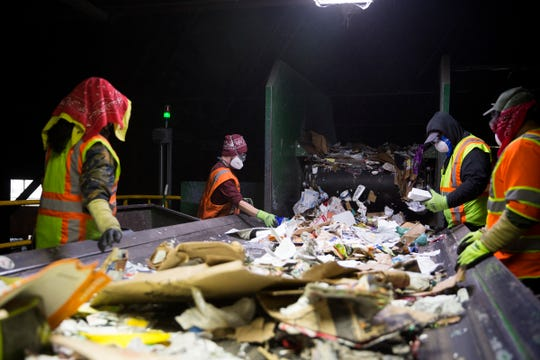 Garten Recycling employees separate recyclable and non-recyclable items in Salem on Thursday, Dec. 20, 2018.