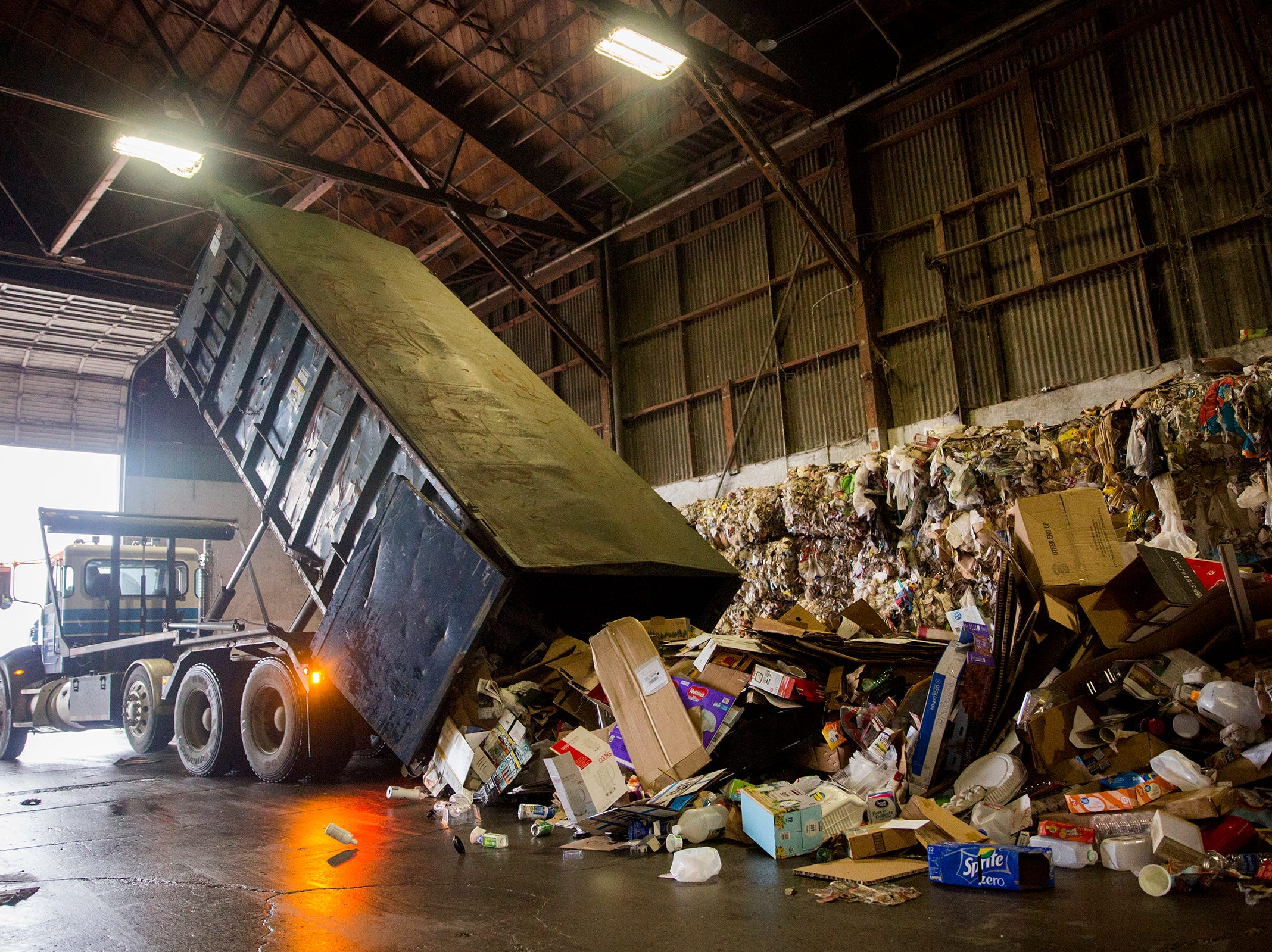 A recycling truck dumps cardboard and other materials at Garten Recycling in Salem on Thursday, Dec. 20, 2018.