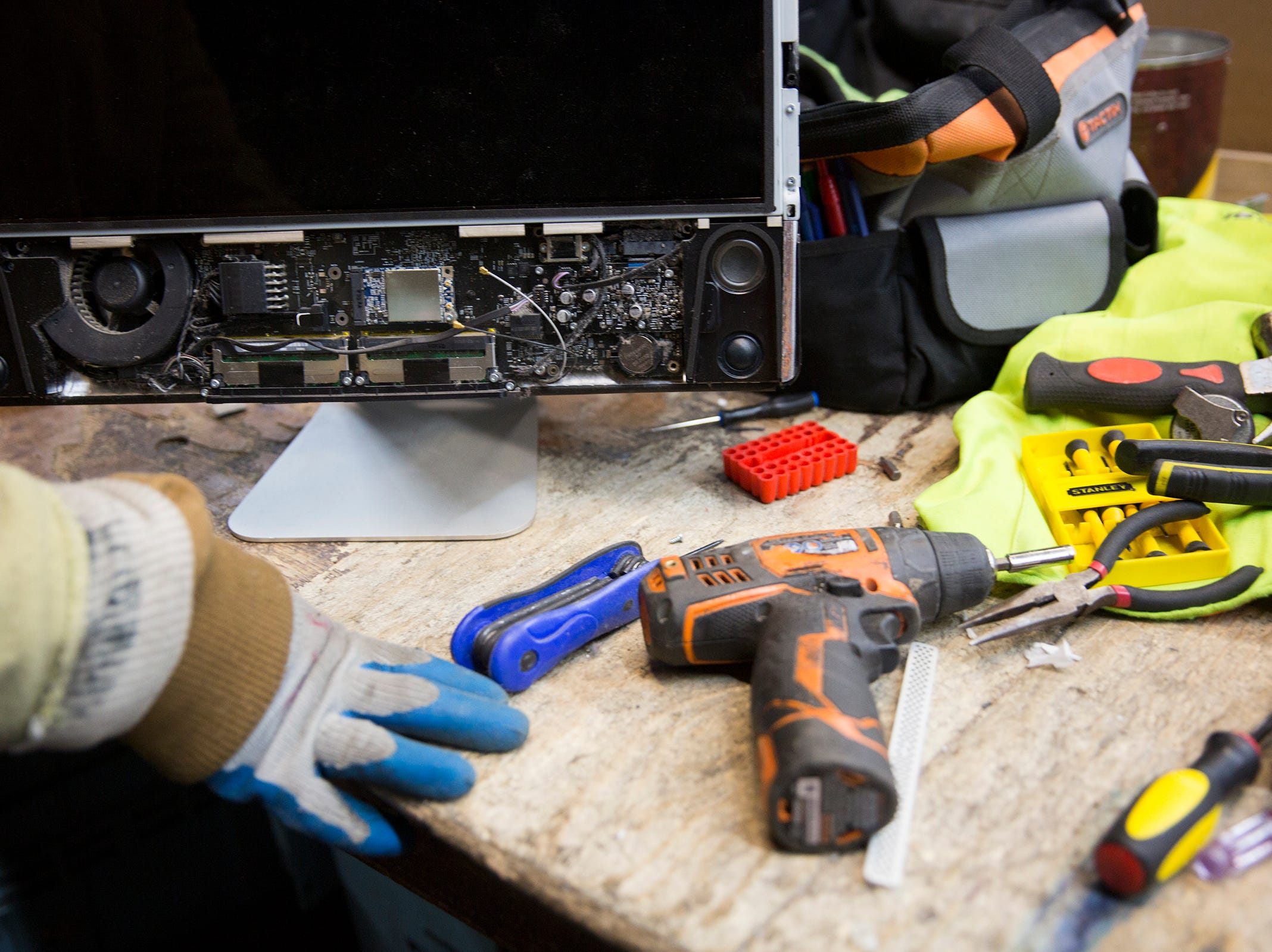 A Garten Recycling employee takes apart a computer in Salem on Thursday, Dec. 20, 2018. By law, electronics have to be disposed at designated drop off areas.