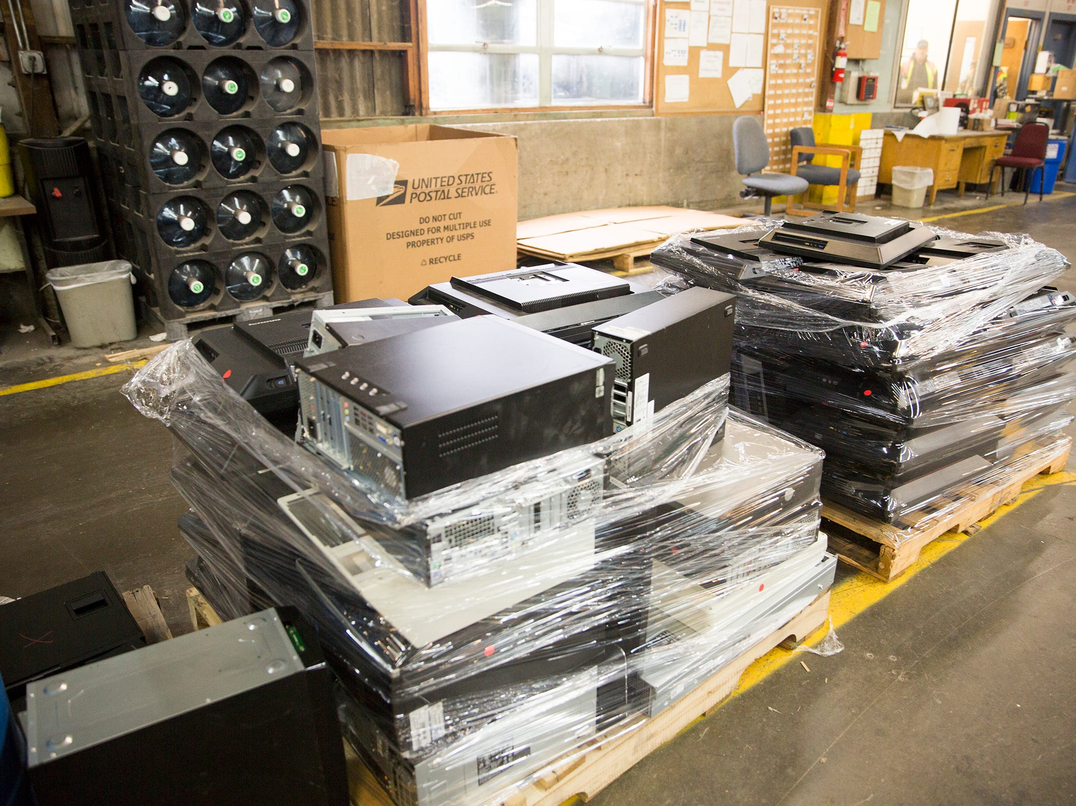 Computer parts are recycled at Garten Recycling in Salem on Thursday, Dec. 20, 2018.