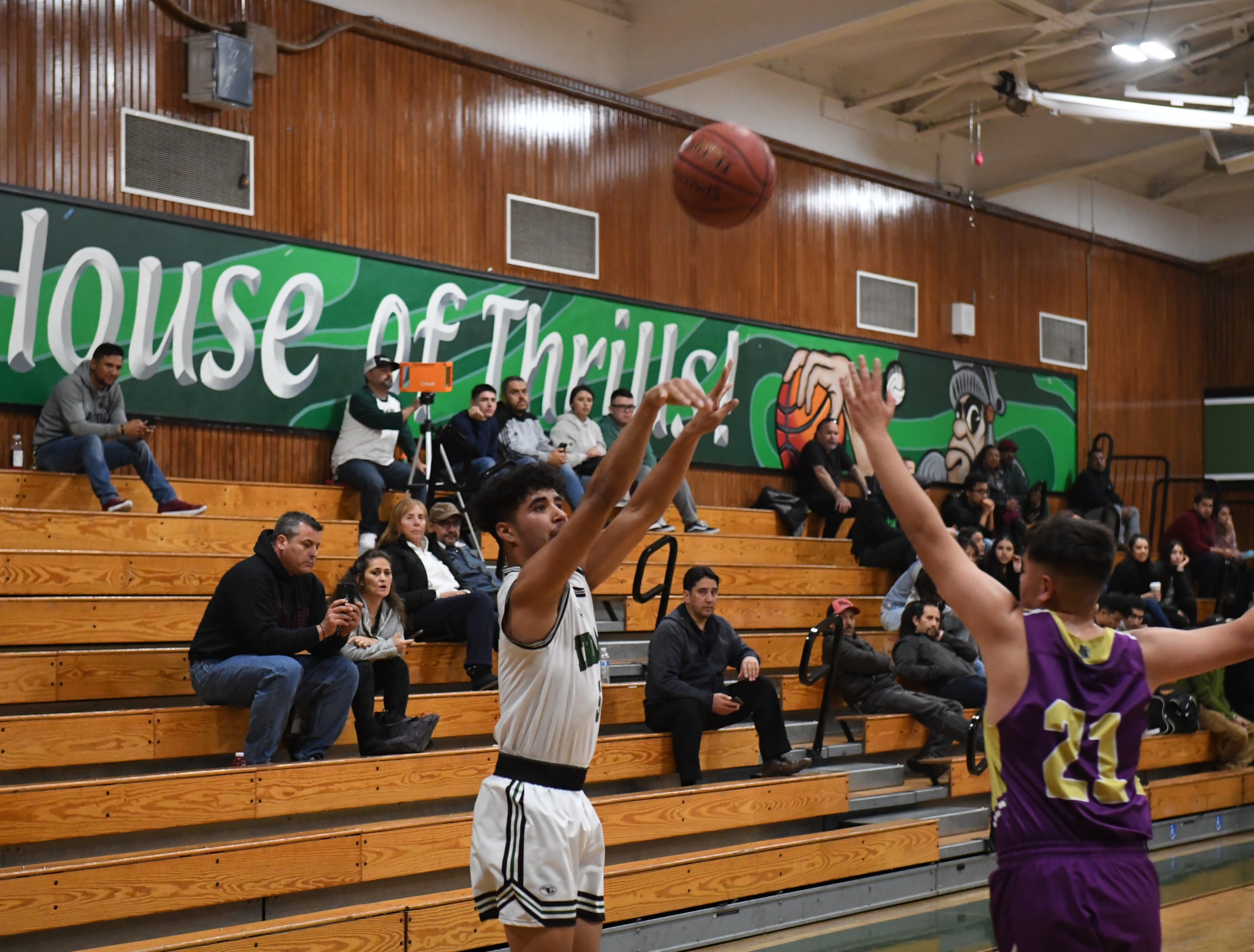Alisal forward Israel Corona (5) shoots a 3-pointer from the left baseline.