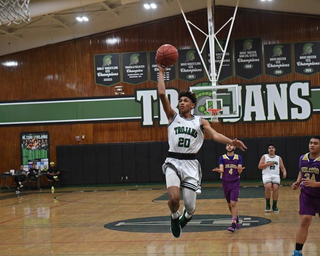 Alisal guard Izahias Carrillo (20) rises up for a layup in the waning seconds of the first half of a game in last year's Solis-Miles Invitational.