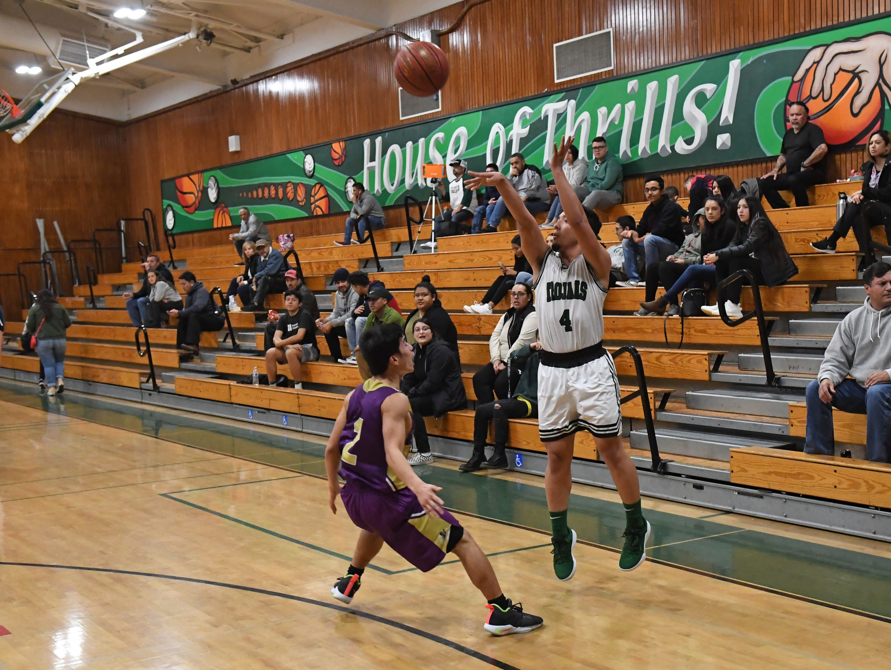 Alisal guard Jose Pulido (4) knocks down a 3-point shot from the right baseline.