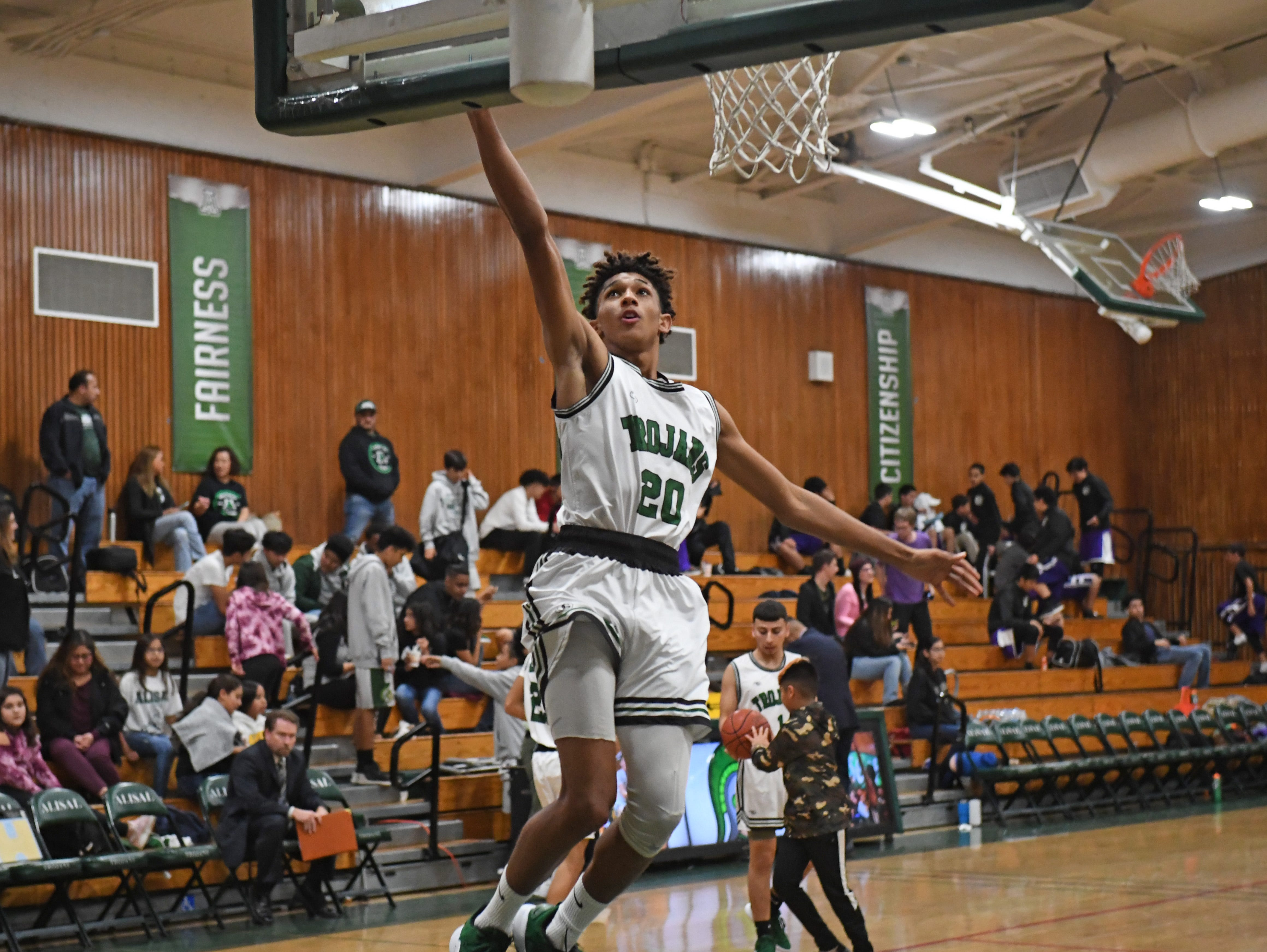 Alisal guard Izahias Carrillo (20) puts up a layup during halftime.