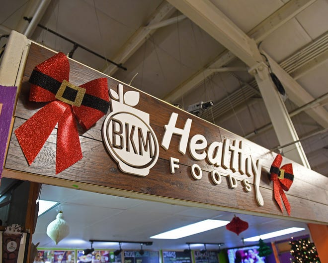 The holiday season's increased foot traffic for BKM Healthy Foods. Though it's more stress for the owners, the family's glad to see more happy customers.