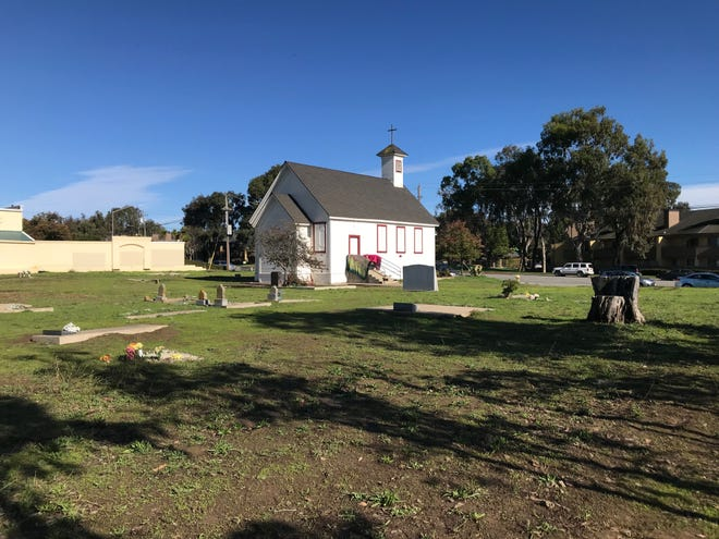 Santa Rita Church and the surrounding cemetery, where some of the oldest Salinas residents are buried.