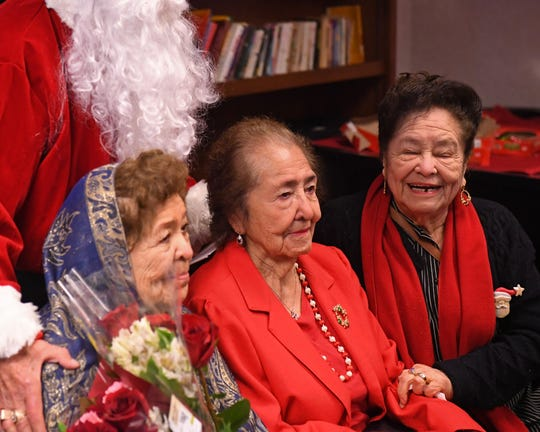 Virginia Corona (far left) and her family members get together for a photo during the Posada celebration Friday morning.