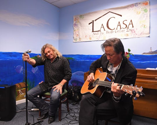 """Once La Casa's carolers finished up the songs with """"Feliz Navidad,"""" local musicians treated the audience to holiday tunes as well as classic rock songs."""
