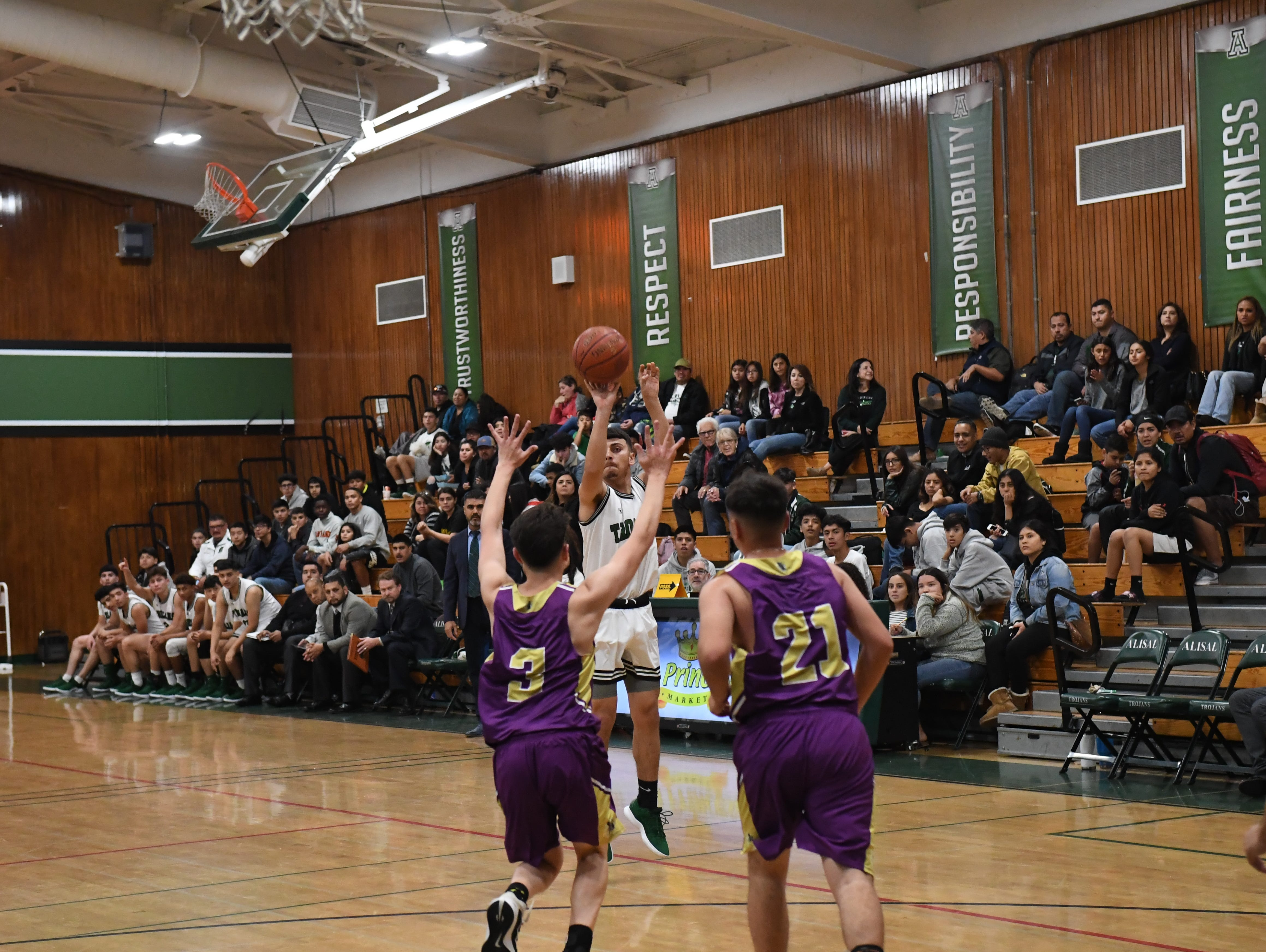 Alisal guard Danny Martinez (1) launches a 3-pointer in the first half.