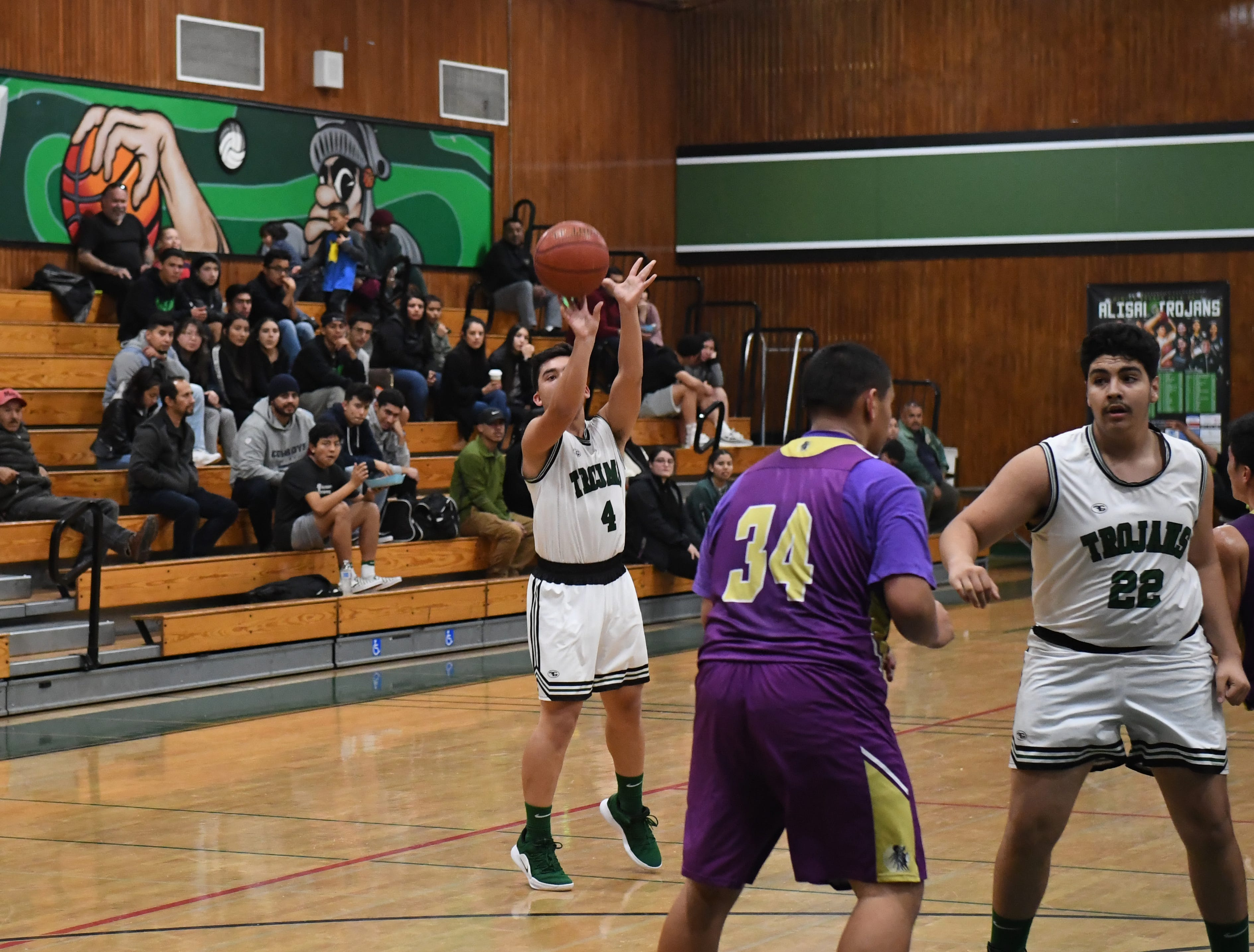 Alisal guard Jose Pulido (4) puts up a shot from beyond the arc.