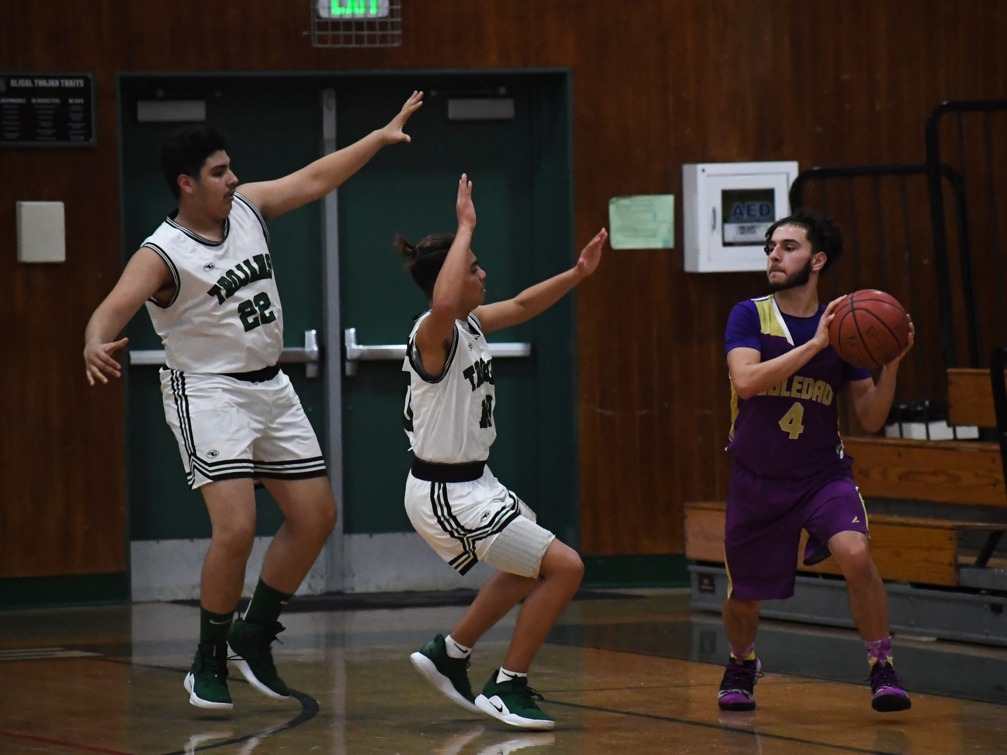 Alisal guard Vincent Gonzalez (10) and center Richard Solis III (22) force a Soledad guard to pick up his dribble.