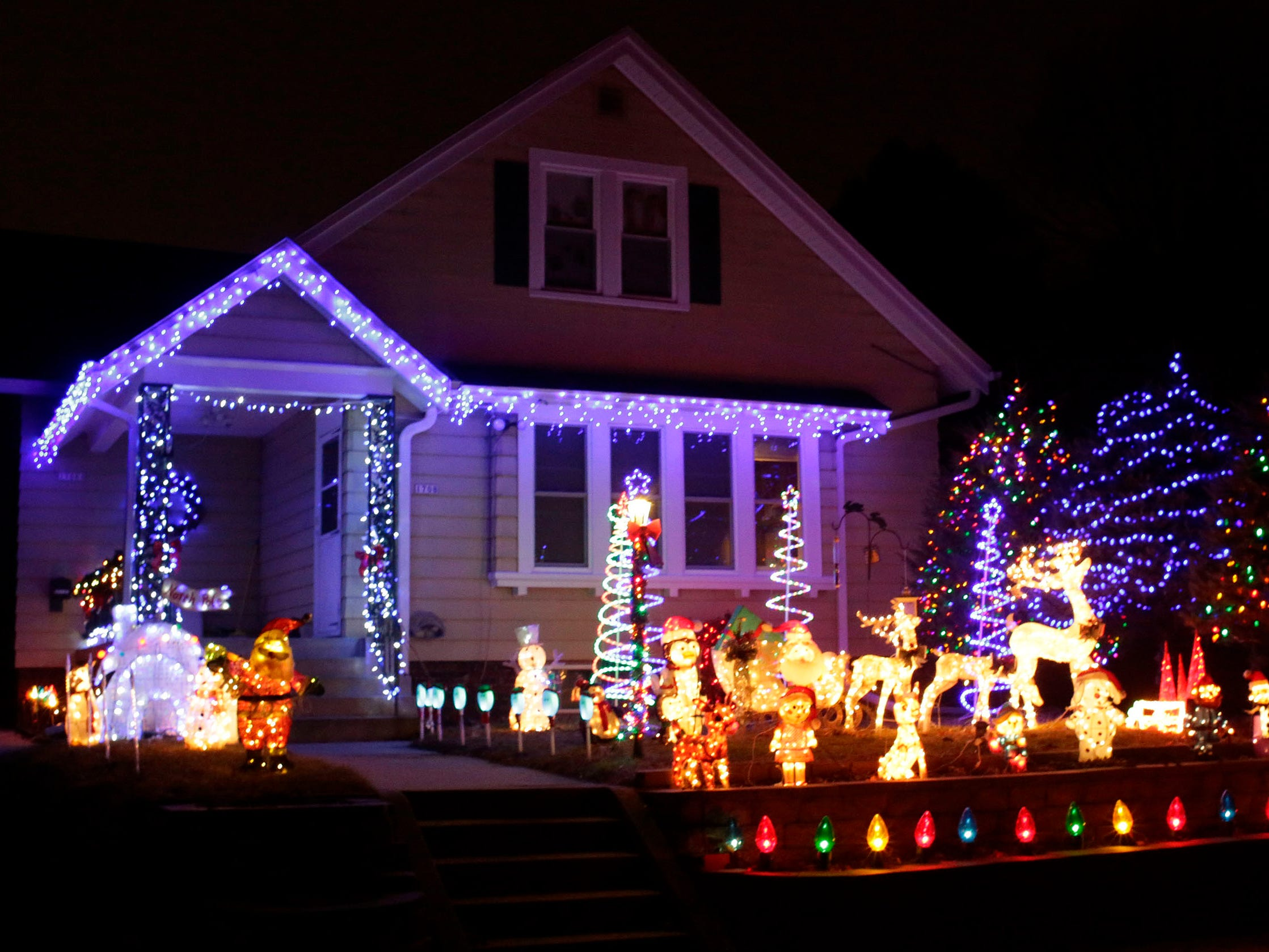 A home is decorated for the holidays on North 4th Street, Thursday, December 20, 2018, in Sheboygan, Wis.