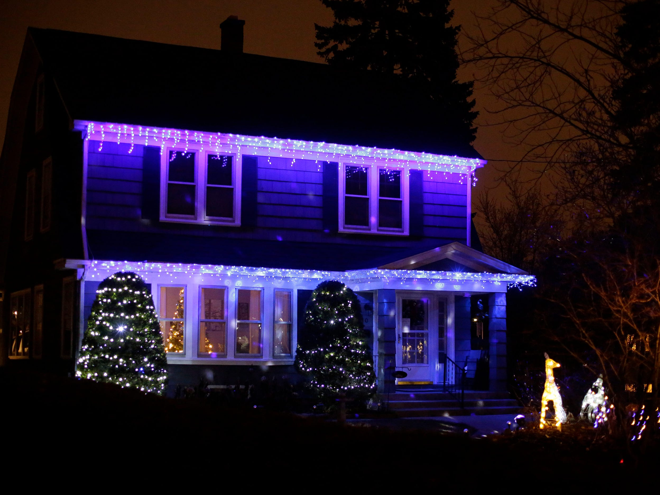 A home is decorated on Erie Avenue, Thursday, December 20, 2018, in Sheboygan, Wis.