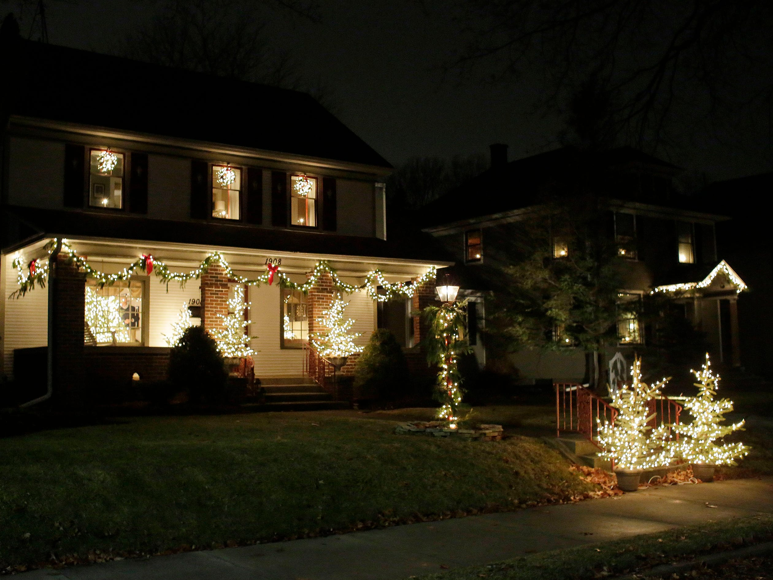 A home is decorated on North 6th Street, Thursday, December 20, 2018, in Sheboygan, Wis.