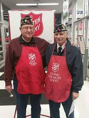 Steve Guerrini, right, helped the Salvation Army by collecting donations during the holiday season.
