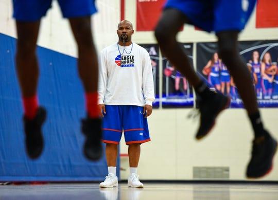 Apollo basketball coach Jason Allen watches his players shoot under the basket during practice Thursday, Dec. 20, at Apollo High School.