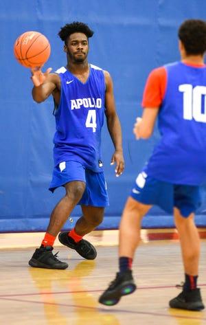 Apollo's Clifton Patterson makes a pass to Lukas Theisen during practice Thursday, Dec. 20, at Apollo High School.