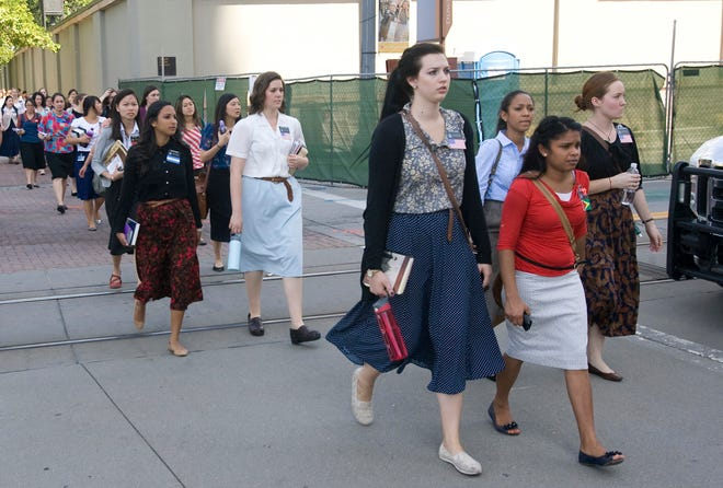 In this 2013 photo, sister missionaries are evacuated from Temple Square in Salt Lake City.