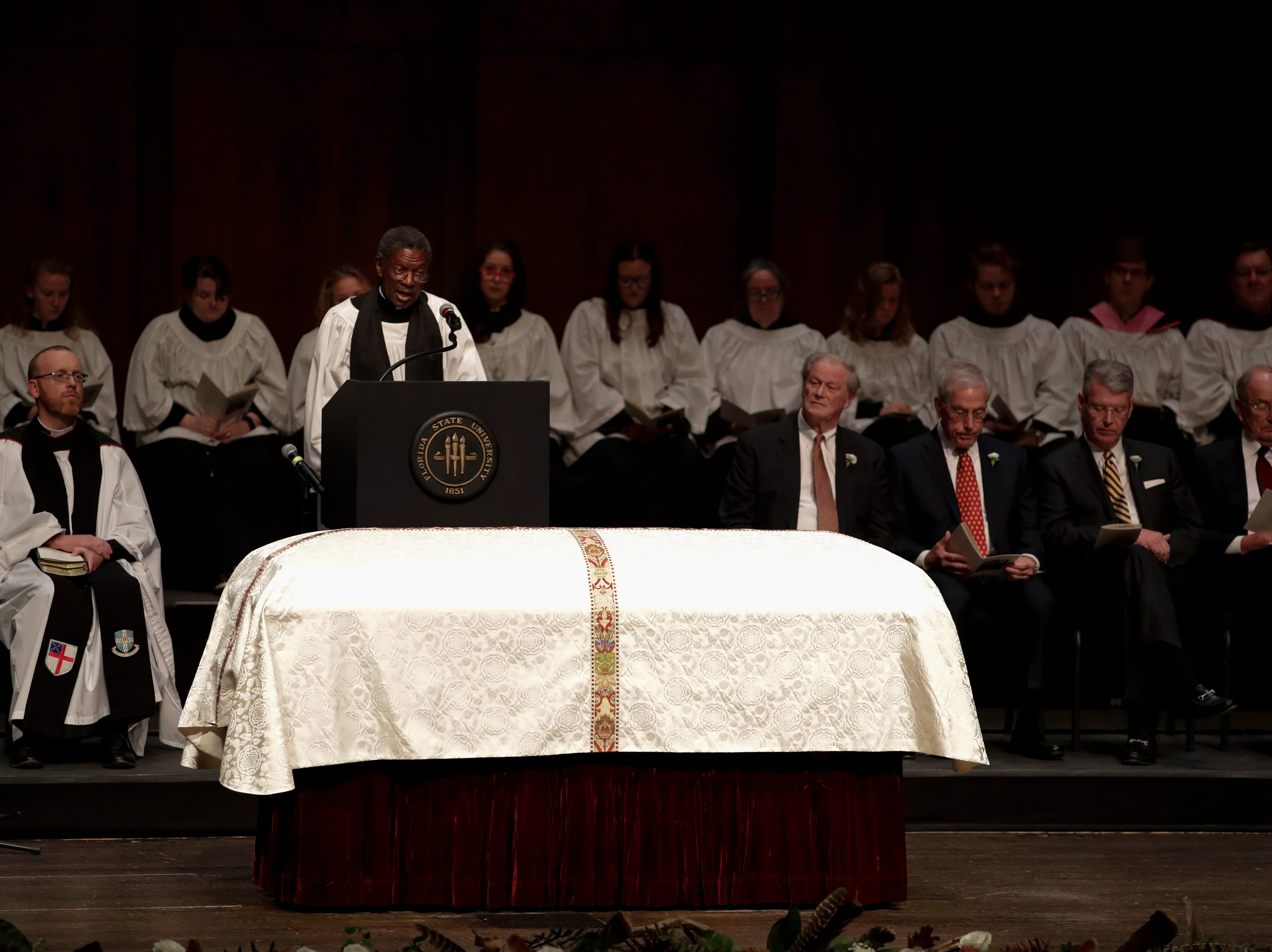 Rev. Joe Bakker reads during a funeral service for Florida State University President Emeritus T.K. Wetherell held at Ruby Diamond Concert Hall Friday, Dec. 21, 2018.
