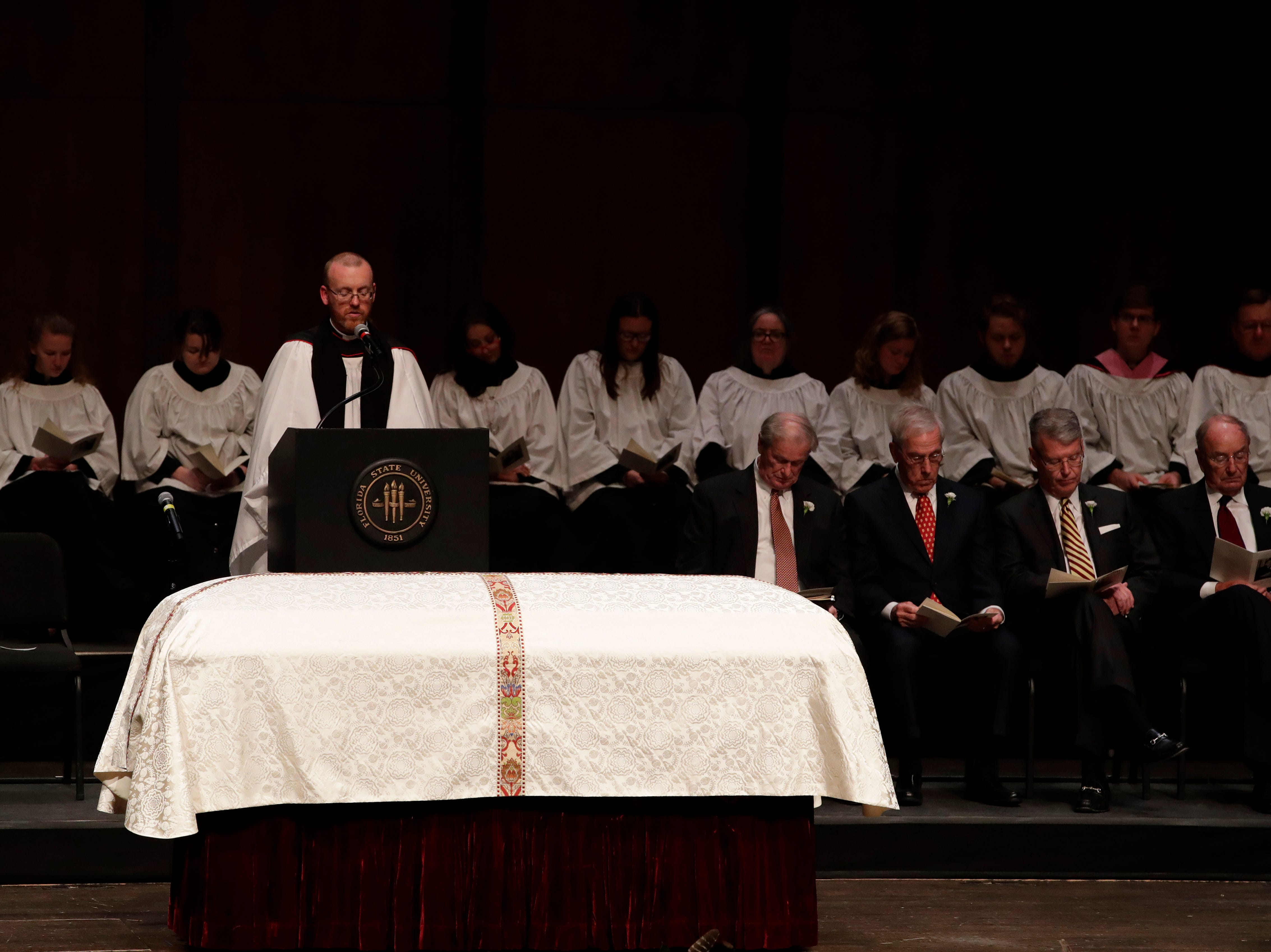 Rev. David Killeen reads Lementations 3:22-26, 31-33 during a funeral service for Florida State University President Emeritus T.K. Wetherell held at Ruby Diamond Concert Hall Friday, Dec. 21, 2018.