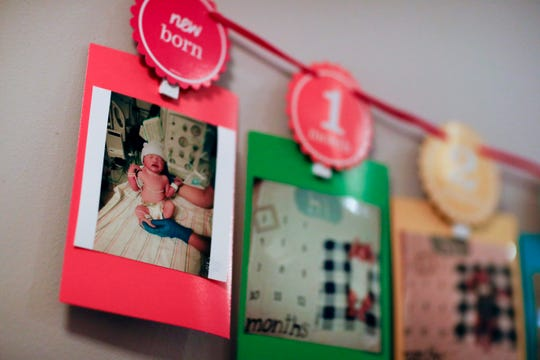 A photo of Jayant Karnik as a newborn hangs in the hallway of his grandmother's home during his first birthday party Sunday, Dec. 9, 2018.