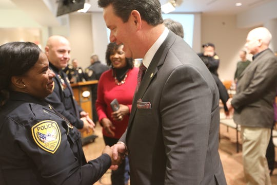 Tallahassee Mayor John Dailey congratulates TPD Lt. Danielle Davis on her promotion on Friday.