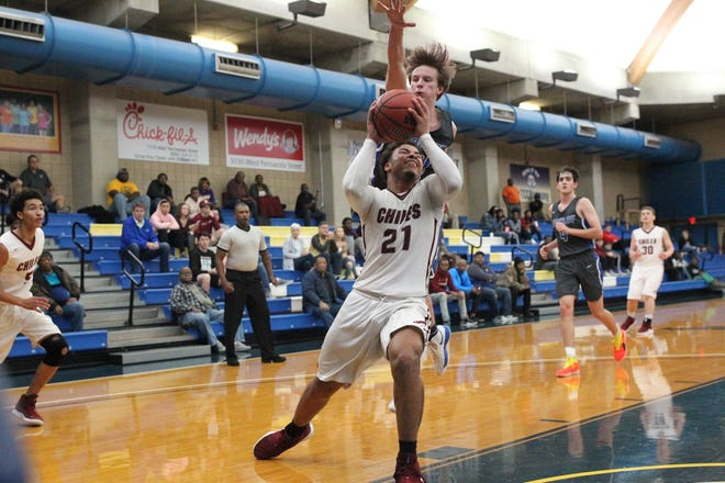 Chiles junior Shantas Nixon drives to the basket under a Maclay defender as Maclay and Chiles play during the 2018 Capital City Holiday Classic at TCC. Nixon had 17 points in three quarters of ablowout win.