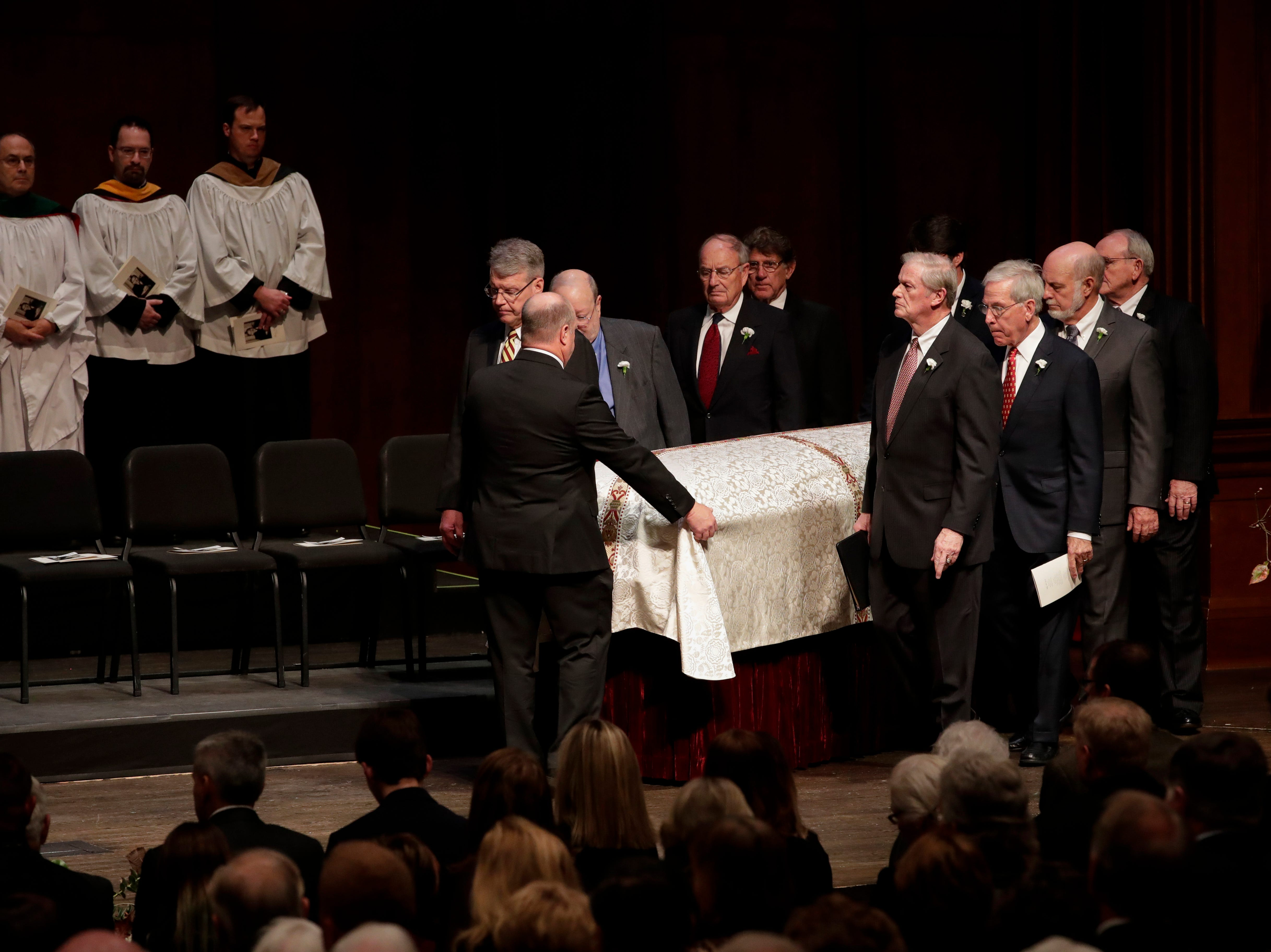 Florida State University President Emeritus T.K. Wetherell's casket is brought into Ruby Diamond Concert Hall by his pall bearers during his funeral service held at Ruby Diamond Concert Hall Friday, Dec. 21, 2018.