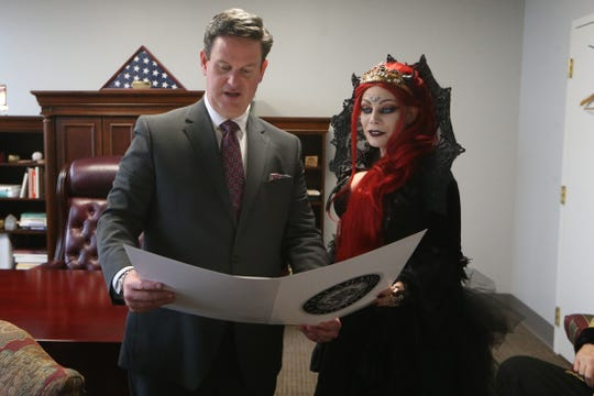 Mayor John Dailey details a City of Tallahassee Proclamation to Barbie Gothe, 46, in honor of Gothe becoming the World Goth Queen, at City Hall, Friday, Dec. 22, 2018.