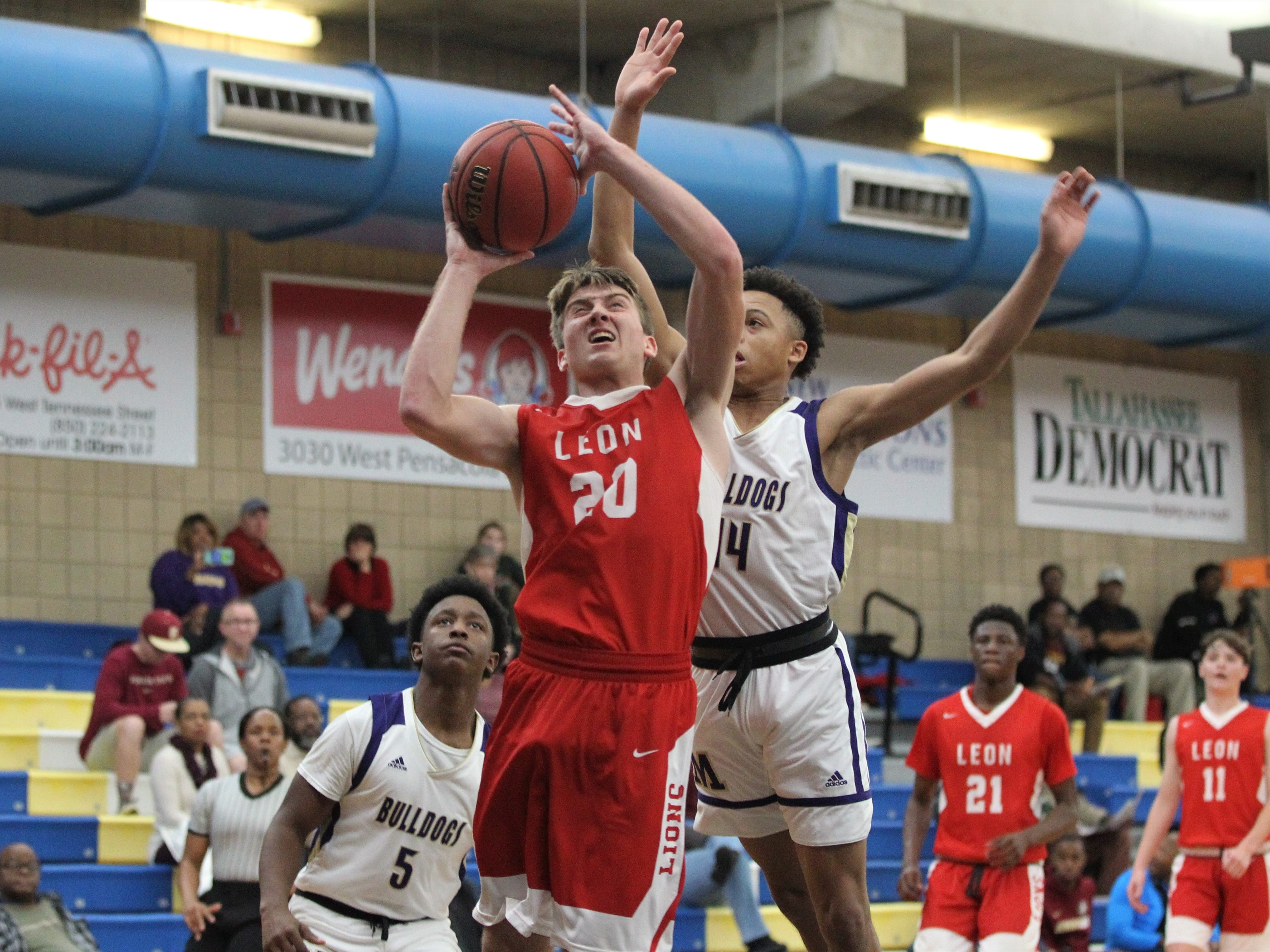 Leon's Dan Campbell goes up for a contested layup as Leon plays Marianna in the 2018 Capital City Holiday Classic at TCC.