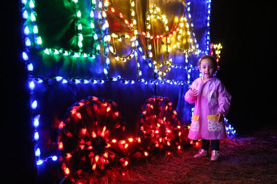 Serhya Brown, 2, is dazzled by the colorful lights on the train light display at Elf Night at Dorothy B. Ovens Park, Thursday, Dec. 21, 2018.