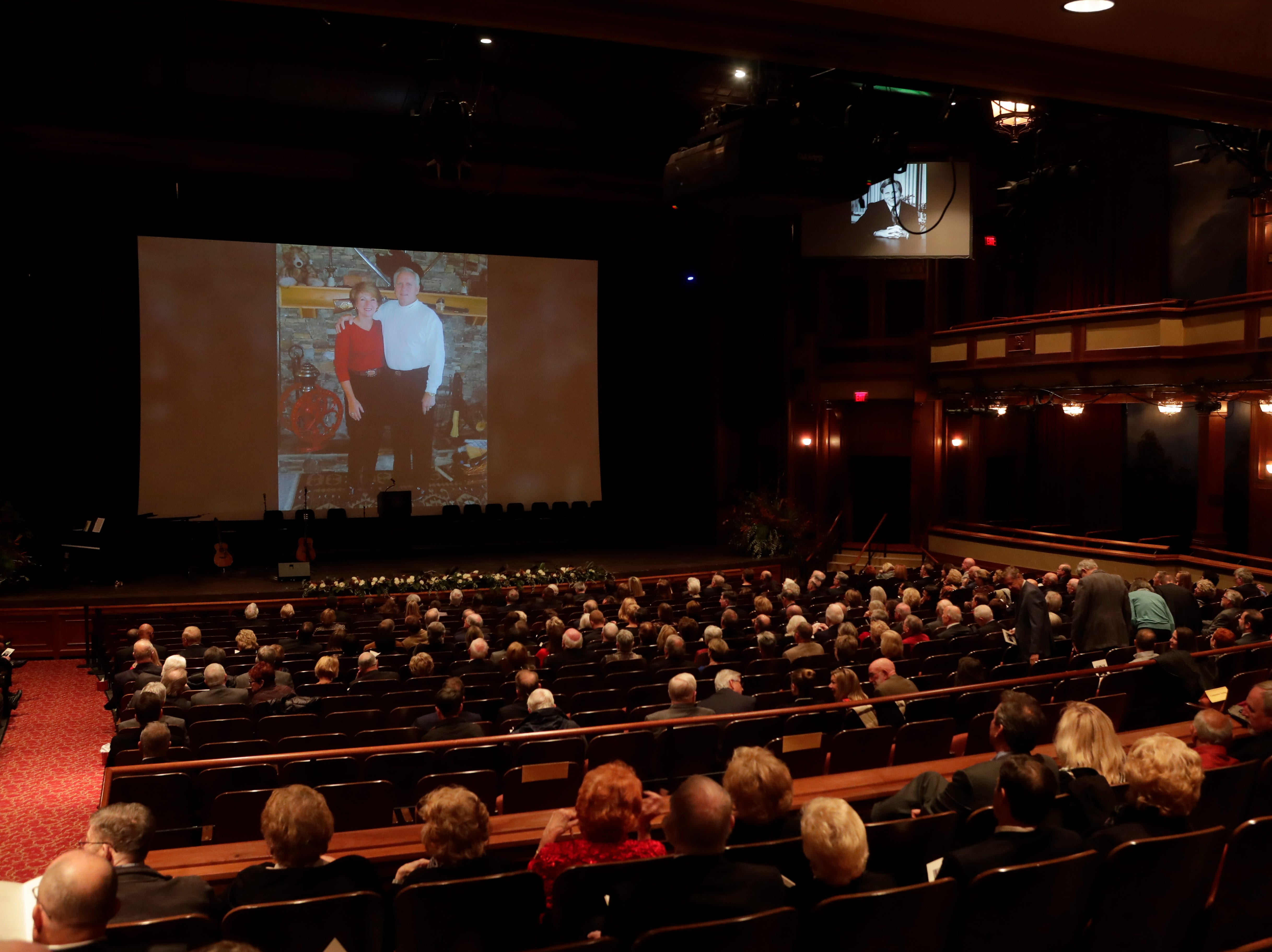 A video of photos of Florida State University President Emeritus T.K. Wetherell plays before a funeral service for Wetherell held at Ruby Diamond Concert Hall Friday, Dec. 21, 2018.