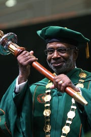 FAMU President Larry Robinson holds the ceremonial mace during his inauguration ceremony at the Lawson Center in November 9, 2018.