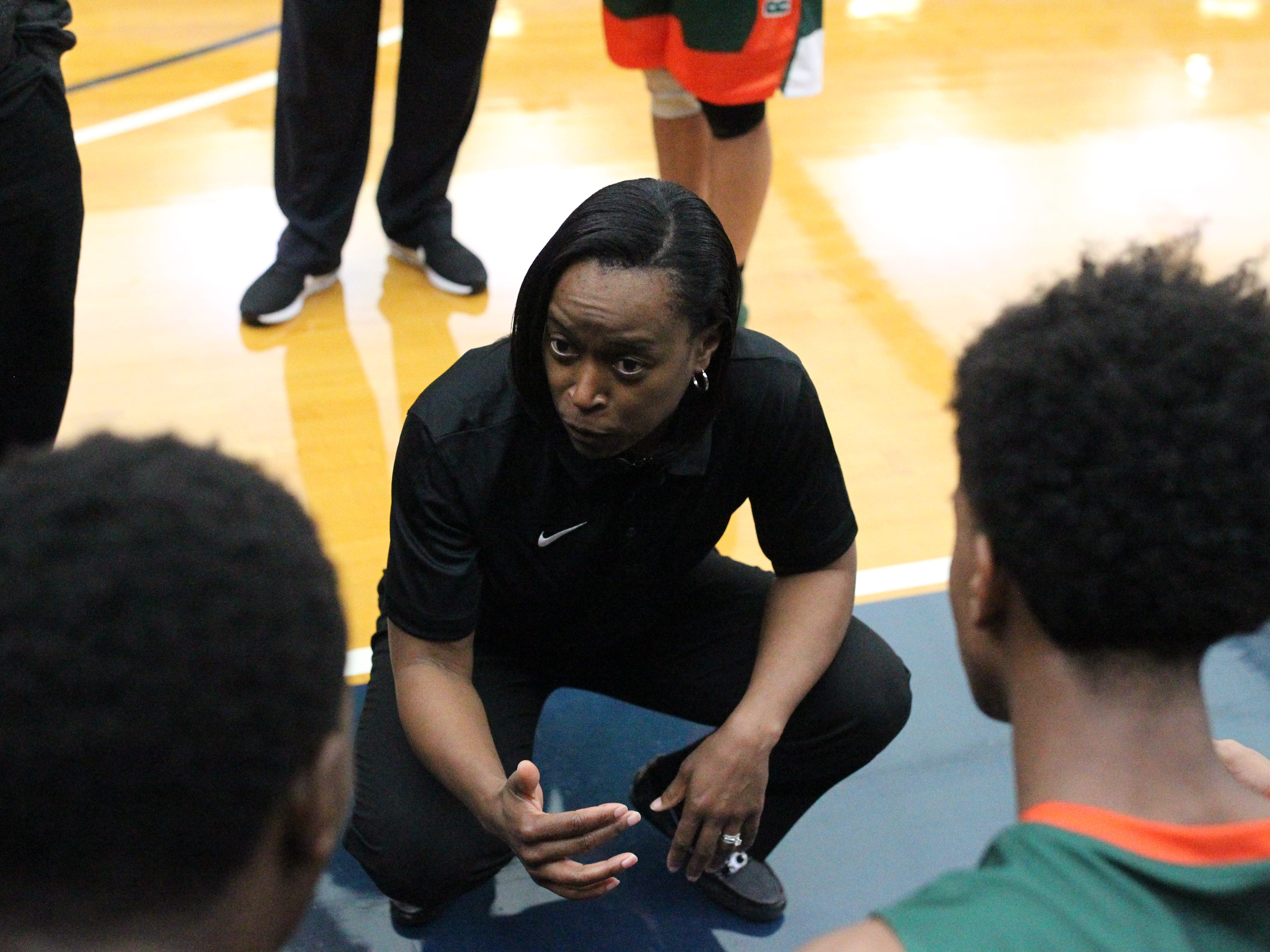 FAMU DRS boys basketball coach Dione Desir talks to her team during a timeout at the 2018 Capital City Holiday Classic at TCC.