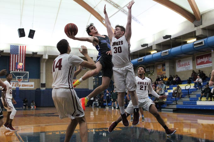 Maclay's Jack Murrah goes up for a layup as  Chiles' Maclay and Chiles play during the 2018 Capital City Holiday Classic at TCC.