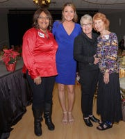 Curletha Campbell, left, WPTV's Erin Guy, Bonnie Royster and J.C. Stern at the 13th annual Poinsettia Power! Holiday Bazaar, Luncheon and Fashion Show.