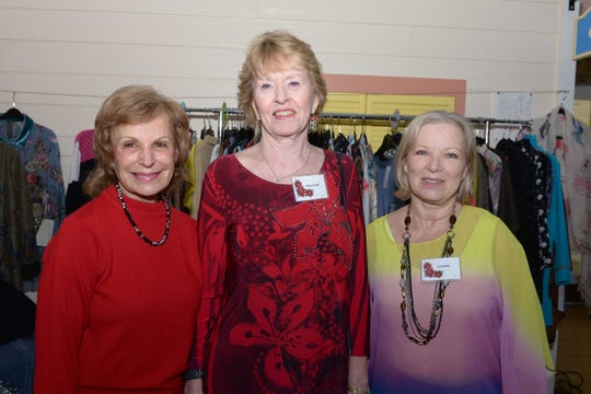Pat Tiemeyer, left, Nancy Cassel and Lori Baird at the 13th annual Poinsettia Power! Holiday Bazaar, Luncheon and Fashion Show.