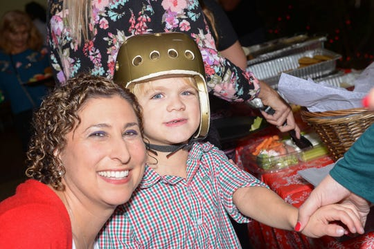 Amy Manko and Dalton at a holiday party for Little Treasures patients at Treasure Coast Hospice's Fort Pierce office.
