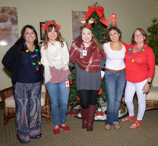 Treasure Coast Hospice staff Jacki Nardone, left,  Jessica Sturgeon, Liz Lung, Amy Manko and Diane Felter at a holiday party for Little Treasures patients at Treasure Coast Hospice's Fort Pierce office.