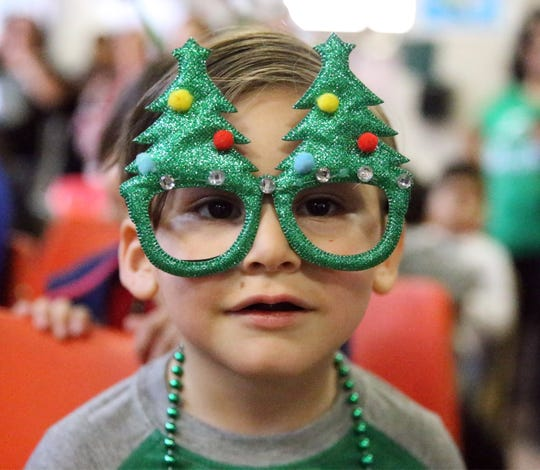 Edgar Adame, 4, wears Christmas tree glasses at the annual U.S. Border Patrol Christmas Party on Friday in the Chihuahuita Community Center.