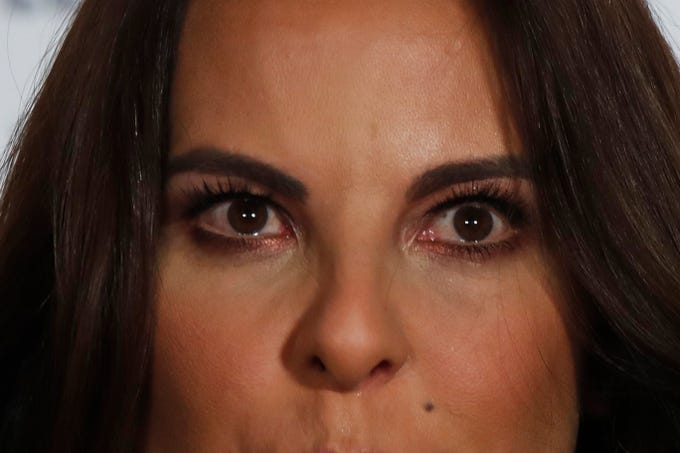 """Mexican actress Kate del Castillo gets teary eyed as she gives a press conference in Mexico City, Thursday, Dec. 20, 2018. Del Castillo spoke about events surrounding her 2015 meeting with Joaquin """"El Chapo"""" Guzman, a Mexican drug lord who at the time was hiding from authorities. When del Castillo met with Guzman, she said it was with the intent to make a film about his life."""