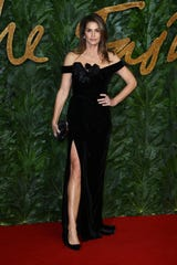 Model Cindy Crawford poses for photographers upon arrival at The Fashion Awards 2018 in central London, Monday, Dec. 10, 2018.