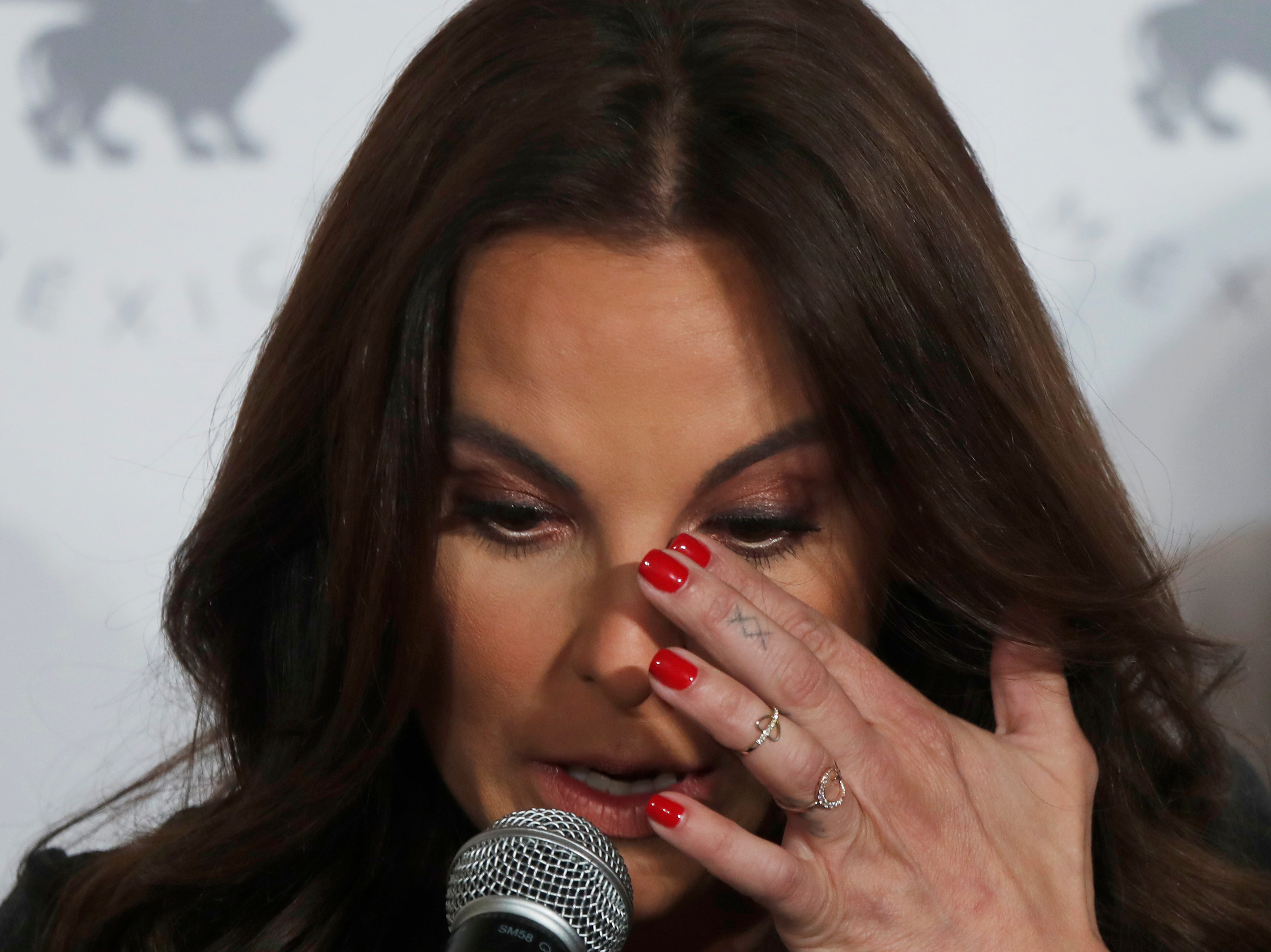 """Mexican actress Kate del Castillo wipes tears as she gives a press conference in Mexico City, Thursday, Dec. 20, 2018. Del Castillo spoke about events surrounding her 2015 meeting with Joaquin """"El Chapo"""" Guzman, a Mexican drug lord who at the time was hiding from authorities. When del Castillo met with Guzman, she said it was with the intent to make a film about his life."""