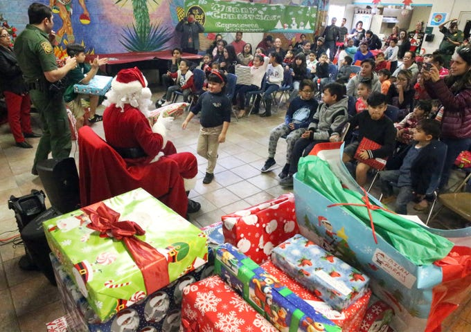 "Santa Clause hands out gifts to more than 100 youngsters during the 26th annual U.S. Border Patrol Chihuahuita Christmas Party Friday at the Chihuahuita Community Center at 417 Charles Road. ""Its one of the things Border Patrol likes to do for the community,"" said spokesman Carlos Antunez, adding that the children from the neighborhood see them every day. Santa rode up in back of a pickup truck as children waited for him to arrive outside the community center. They were treated to holiday-themed snacks."