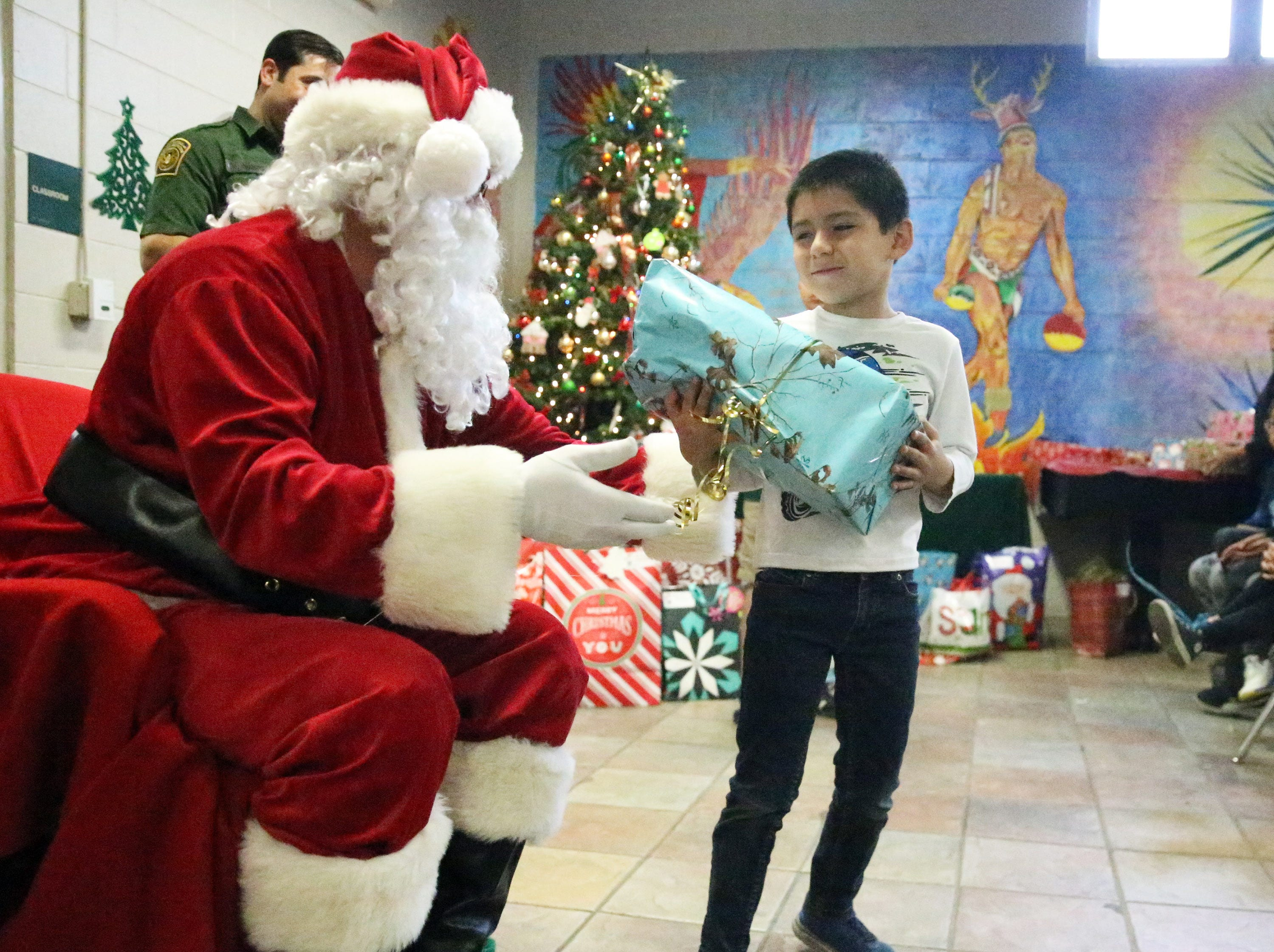 Children get gifts Friday at the Chihuahuita Community Center.